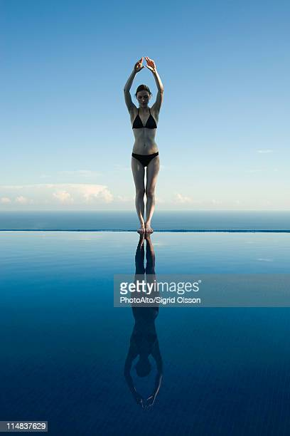 Woman preparing to dive into pool