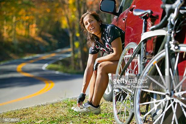 woman preparing to go on bicycle ride in autumn - blacksburg stock pictures, royalty-free photos & images