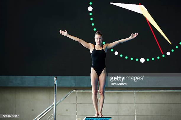 woman preparing to high dive