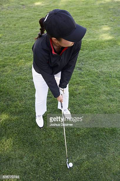Woman Preparing to Hit a Golf Ball
