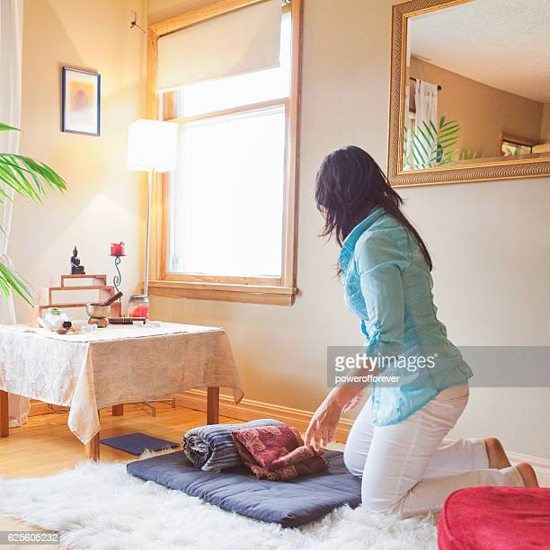 Woman preparing to meditate at home