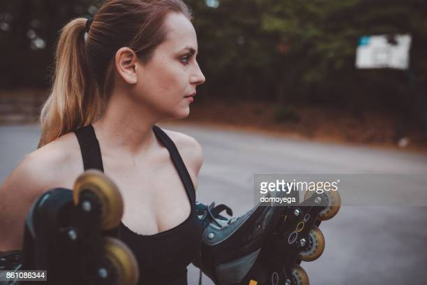 woman preparing to roller skate - inline skate stock photos and pictures