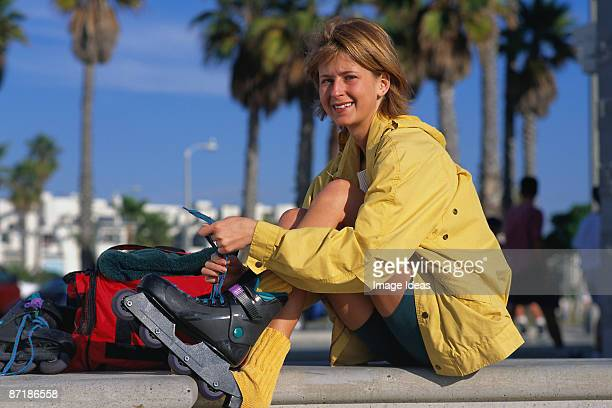 Woman preparing to rollerblade