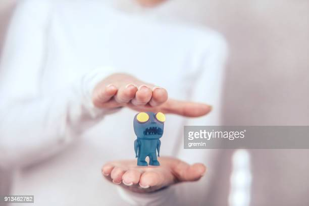 Woman presenting prototype toy monster