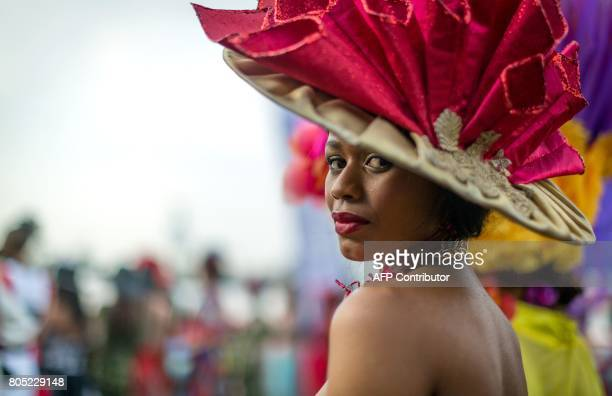 A woman presents a creation of a local designer during a fashion show at the 2017 edition of the Durban July horse race in Durban on July 1 2017 The...