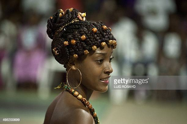 A woman presents an AfroColombian hairstyle during the 10th contest of Afrohairdressers Tejiendo Esperanzas on June 1 in Cali Valle del Cauca...
