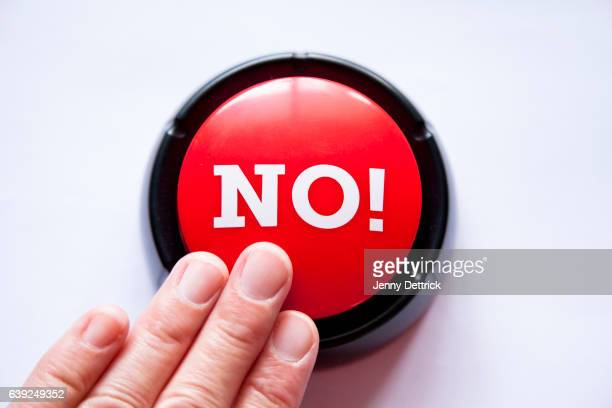 woman pressing a button that says no! - dismissal stock photos and pictures