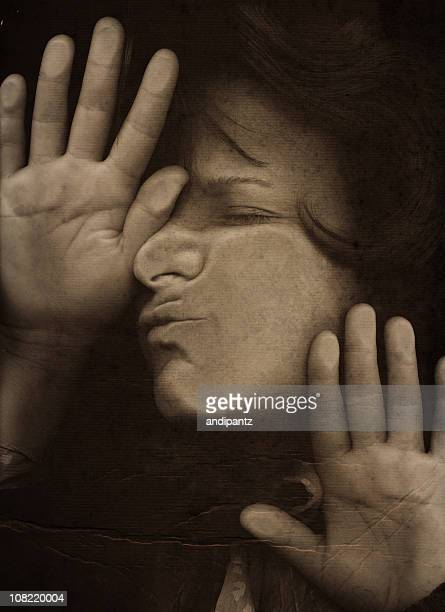 Woman Pressing Face and Hands Against Glass, Sepia Toned