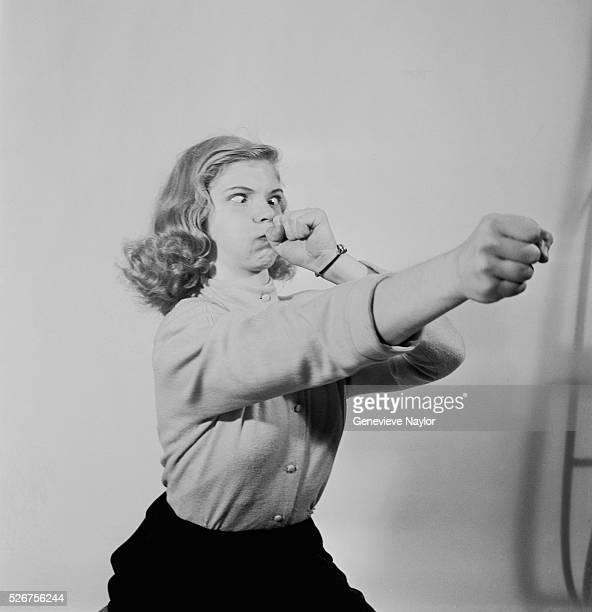 Woman Pretending to Play Trombone