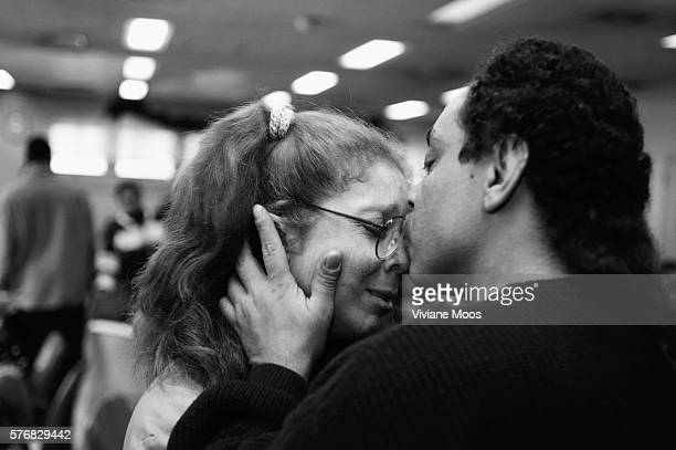 A woman prisoner gets a kiss from a family member at a Christmas party in prison on Rikers Island | Location Rikers Island New York USA