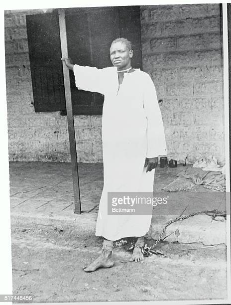A woman prisoner stands in chains at the barracks prison in which 194 persons died at Kosti Sudan The mass deaths followed the cramming of 285...