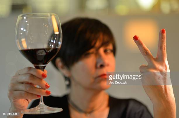 woman promises to drink no more than 2 glasses - depczyk stock pictures, royalty-free photos & images