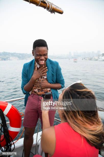 woman proposing to man on sailboat - black women engagement rings stock pictures, royalty-free photos & images