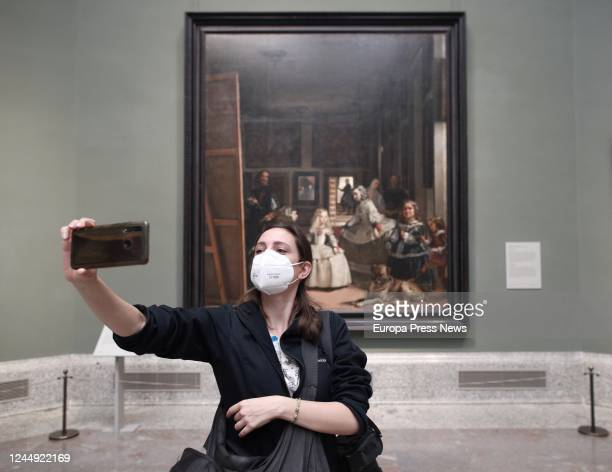 Woman protected with a mask takes a picture at the facilities during the presentation of the reopening of the Prado Museum, which will take place on...