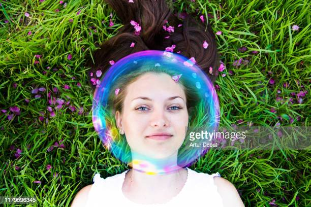 woman protected with invisible bubble against allergies during springtime. - mikroorganism bildbanksfoton och bilder