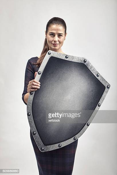 woman protecting herself with a shield - shield stock pictures, royalty-free photos & images