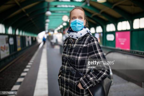 woman protective face mask on metro station - passenger train stock pictures, royalty-free photos & images