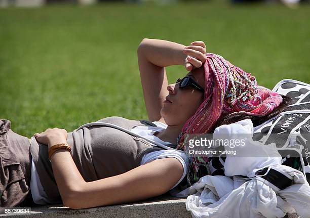 A woman protects her self from the sun in Piccadilly Gardens on June 29 2009 in Manchester England Forecasters have predicted a heatwave across...