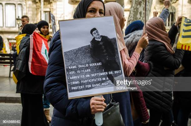 A woman protester seen displaying a poster with the portrait of one of the people in prison Third March in Barcelona by the resistance freedom and...