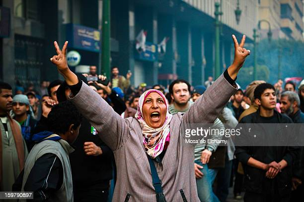 Woman protester waves the victory sign during clashes with military police near Tahrir square.