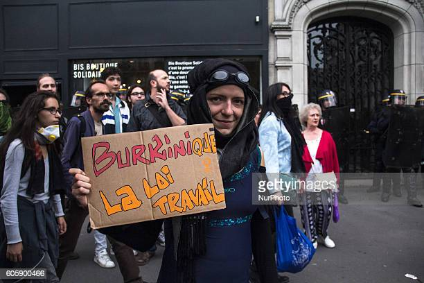 A woman protestes over the controversial Burkini issue as she protest against Labor reform law in Paris on September 15 2016 Parisians took out the...