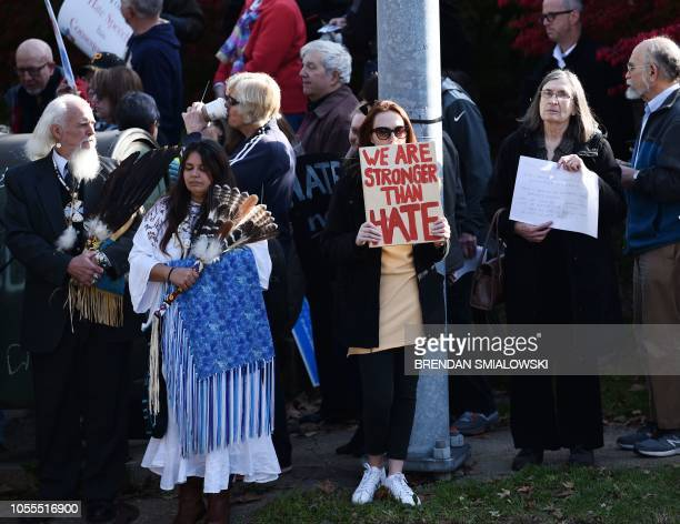 A woman protesting against US President Donald Trump waits near the Tree of Life Congregation on October 30 2018 in Pittsburgh Pennsylvania The first...