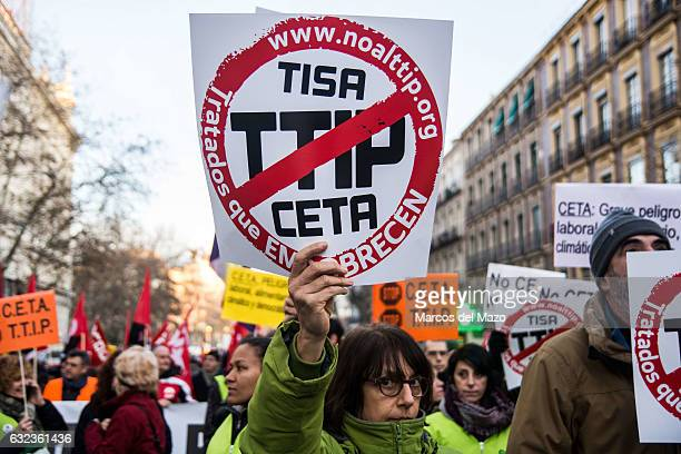 A woman protesting during a demonstration against TTIP CETA and TISA agreements