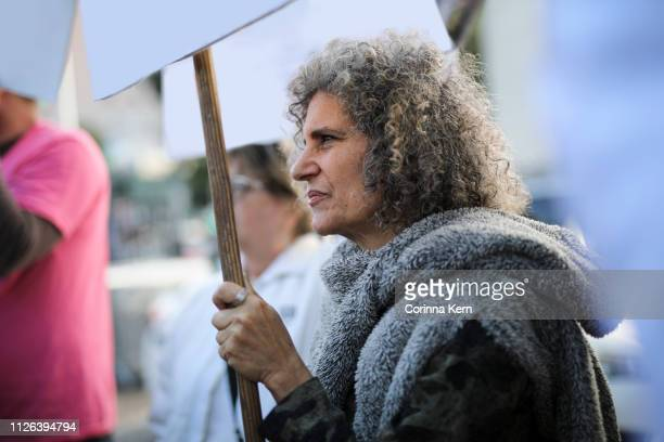 woman protesting - campaigner stock pictures, royalty-free photos & images