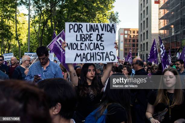 A woman protesting with a placard that reads for a life free of sexist violence during a demonstration to demand that the committed budget against...