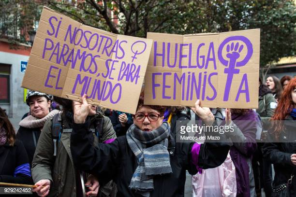 A woman protesting with placards that reads If we stop world stops Feminist strike as a part of demonstration during the first women strike ever in...