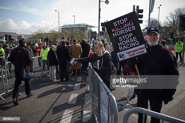 A woman protestor handing out leaflets about animal cruelty to racegoers outside Aintree racecourse on the day of the Grand National meeting Tens of...