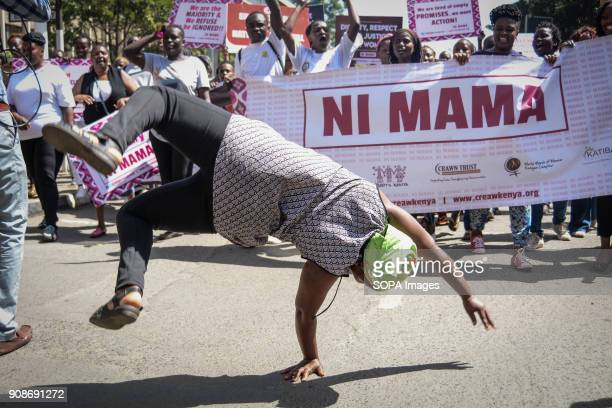 A woman protestor seen making acrobatics turns while protesting against the recent reported rape allegations at the Kenyatta National Hospital the...