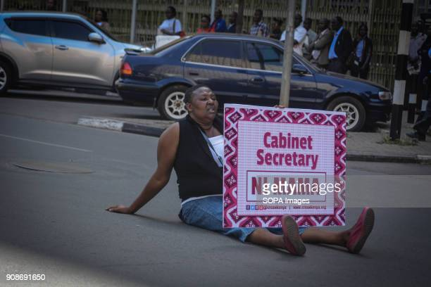 A woman protestor seen seated in the middle of a street in Nairobi to protest against the recent reported rape allegations at the Kenyatta National...
