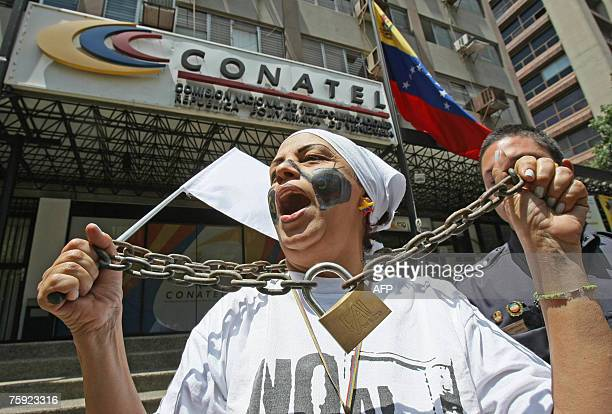 A woman protests against the closure of Venezuela's RCTV radio station before the Telecommunication National Commission in Caracas 01 August 2007...