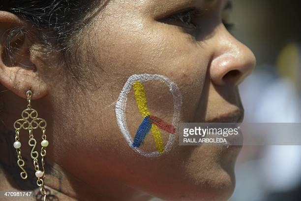 A woman protests against the government of President Nicolas Maduro in Caracas on February 21 2014 Nationwide demonstrations led by students and the...