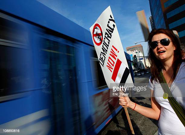 A woman protests against the regime of Egyptian President Hosni Mubarak February 5 2011 in the Westwood neighborhood of Los Angeles California Egypt...