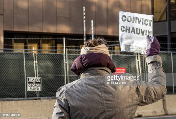 Woman protests outside the Hennepin County Government Center, where the trial of former police officer Derek Chauvin is being held, on March 31, 2021...