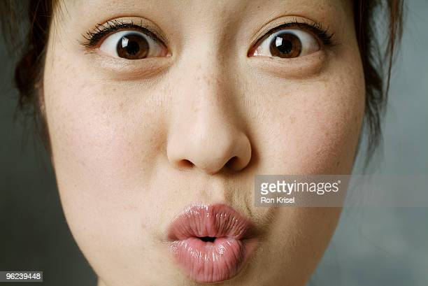 Woman puckering her lips