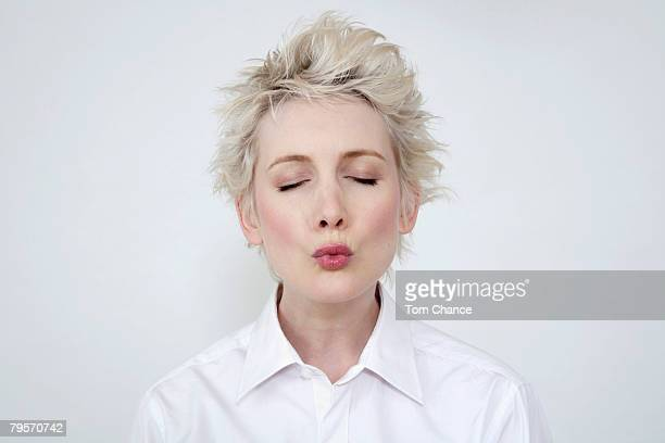 woman puckering her lips, portrait - puckering stock pictures, royalty-free photos & images
