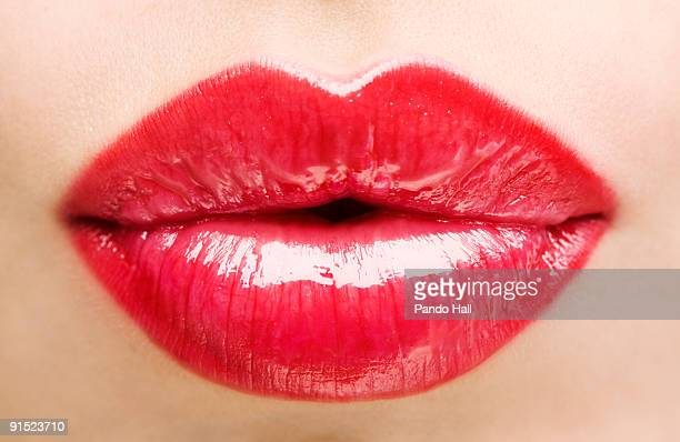 Woman puckering lips, close-up