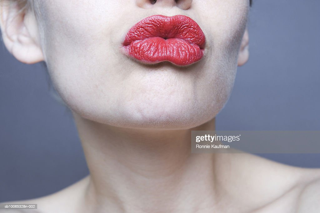 Woman puckering lips, close-up : Foto stock