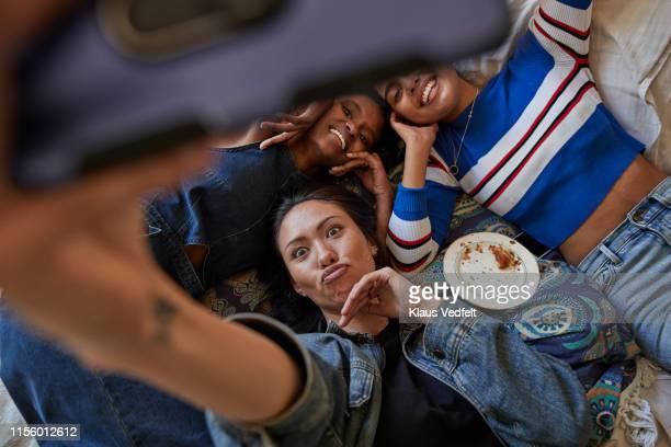 woman puckering while taking selfie with friends - generation z stock-fotos und bilder