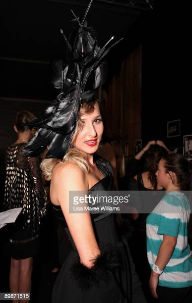 A woman pulled from the street by Alex Perry to model his designs prepares backstage ahead of the Diet CocaCola Little Black Dress show at Rosemount...
