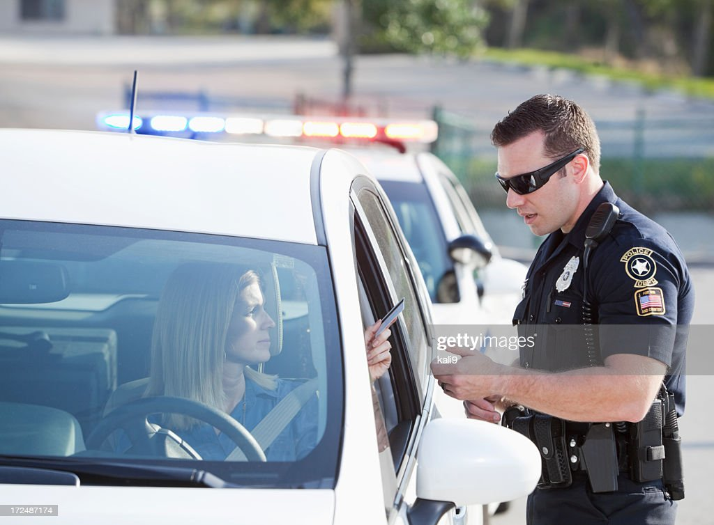 Woman pulled over by police : Stock Photo