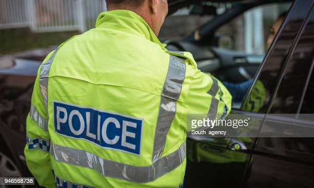 woman pulled over by police - traffic cop stock pictures, royalty-free photos & images