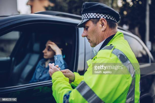 woman pulled over by traffic cop - ticket stock pictures, royalty-free photos & images
