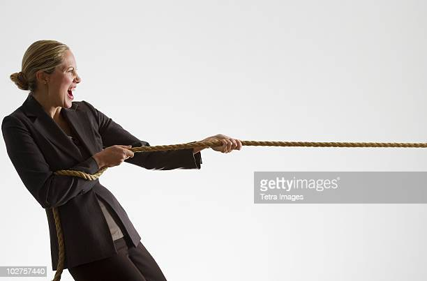 Woman pulling a rope
