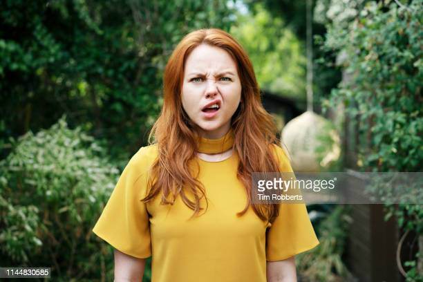 woman pulling face - surprise stock pictures, royalty-free photos & images