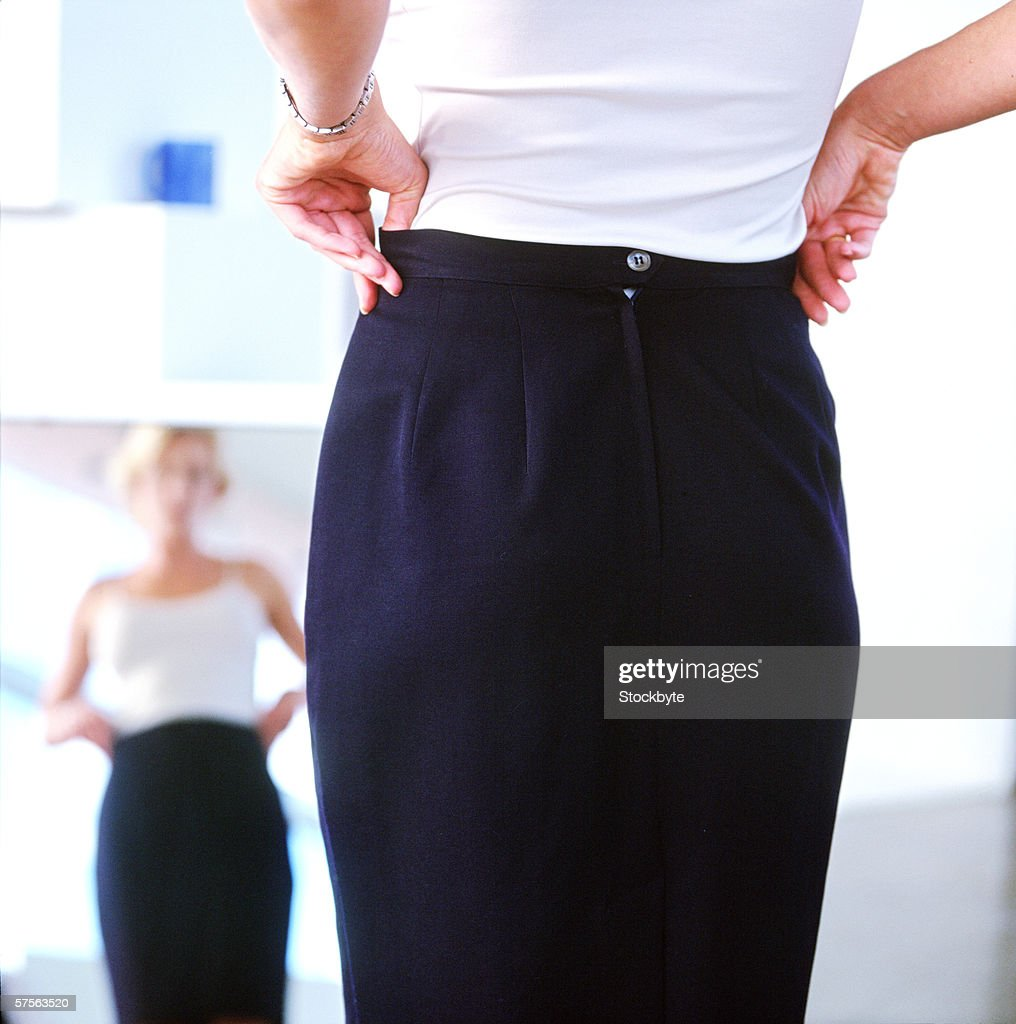 woman pulling her skirt up : Stock Photo