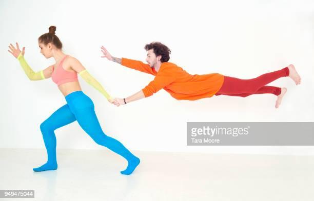 woman pulling man